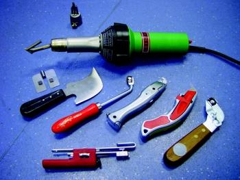 Полный набор инструмента используемый при укладке натурального линолеума