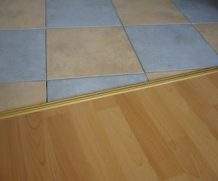 Как красиво сделать стык между плиткой и ламинатом